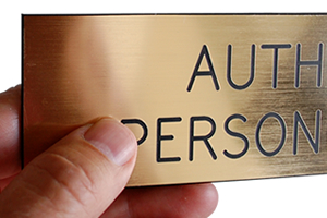 Faux brass plastic engraved signs